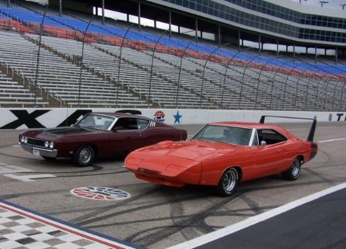 1969 Dodge Daytona and Ford Torino Talladega on the race track