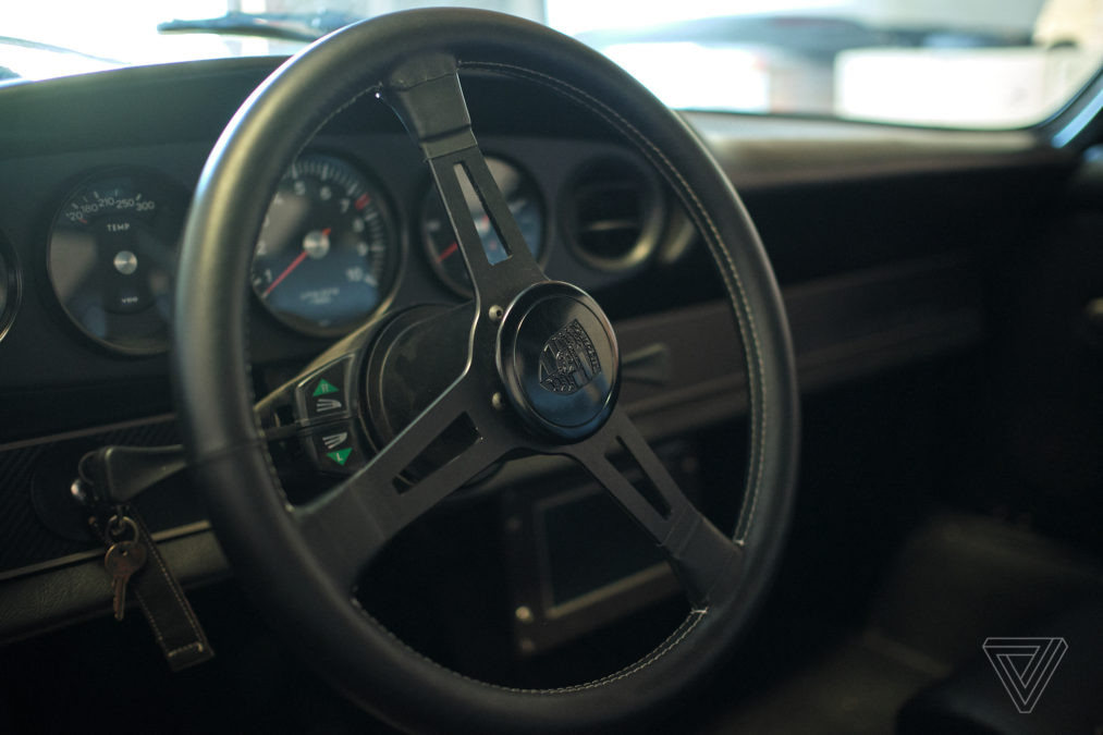 eco-friendly Tesla, Inc. helps modify a vintage Porsche